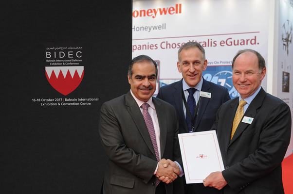 His Excellency Shaikh Fawaz bin Mohammed Al Khalifa, The Ambassador of the Kingdom of Bahrain to the Court of St James shakes hands with Rear Admiral Simon Williams OBE, Chairman of Clarion Defence & Security with Tim Porter, Managing Director of Clarion Defence & Security in attendance after the announcement of BIDEC 2016.